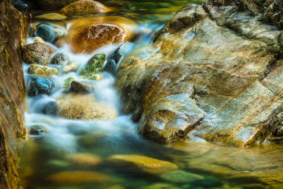 PH2029a creek smooth water and rocks LynnValley pfx zf-1272-3
